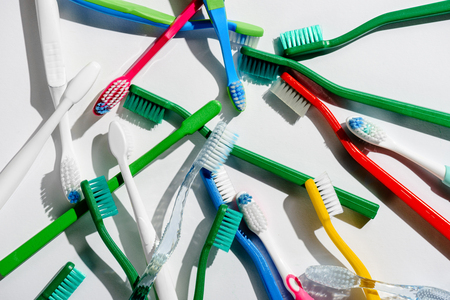 Background with colorful toothbrushes for morning hygiene