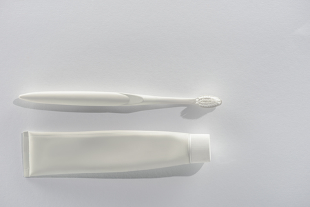Top view of white toothbrush and tube of toothpaste Stock Photo