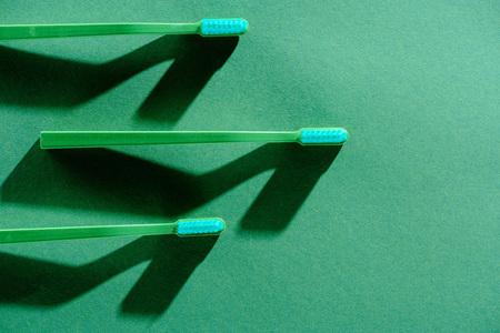 Green toothbrushes, on green Reklamní fotografie