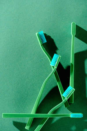 Top view of green toothbrushes