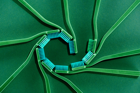 Spiral composition with toothbrushes on green