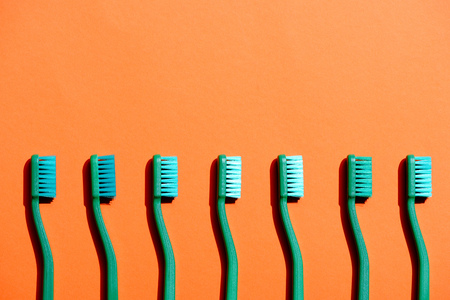Green toothbrushes in row