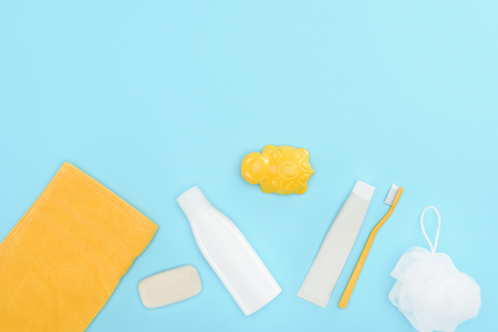 Top view of body lotion, toothbrush, toothpaste, towel and soap Stock Photo