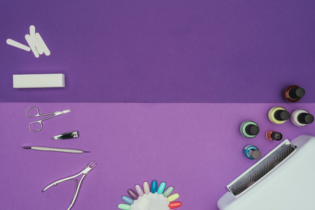 Top view of manicure tools and UV lamp 스톡 콘텐츠