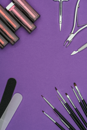 Top view of lipsticks and manicure tools
