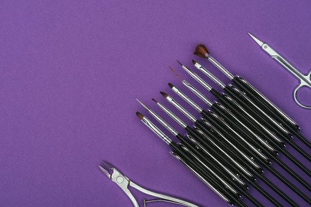 Top view of brushes, scissors and nail nippers 스톡 콘텐츠