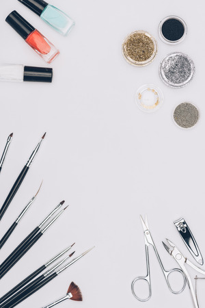Top view of manicure tools and glitter 스톡 콘텐츠