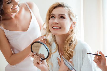 bride getting makeup before wedding Stock Photo