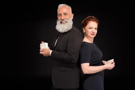 Mann und Frau , die Bündel Geld halten Standard-Bild - 95260879