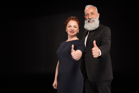 Woman and man showing thumbs up