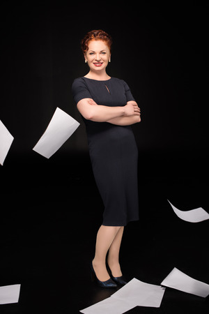 Woman with paper falling around