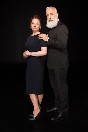 man touching woman on shoulder