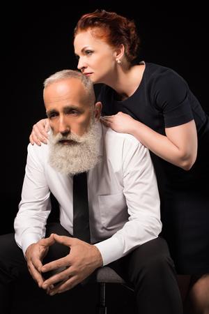 Woman consoling sad man Imagens