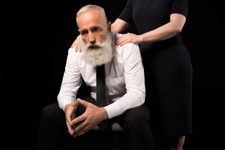Sad man sitting on chair Banco de Imagens