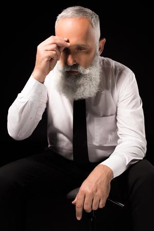 man rubbing nose bridge