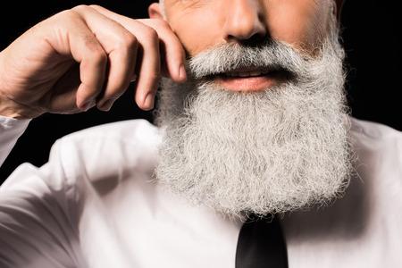 man twisting moustache Imagens