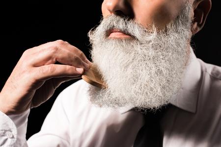 man combing long beard Stock fotó