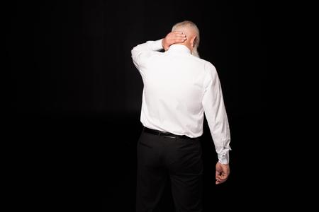 man touching nape of neck Stock Photo