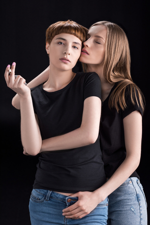 Young woman embracing girlfriend