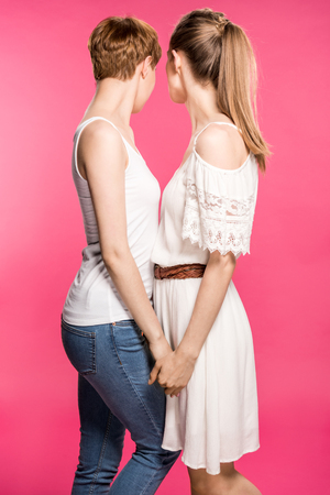 Lesbian couple holding hands Stock Photo