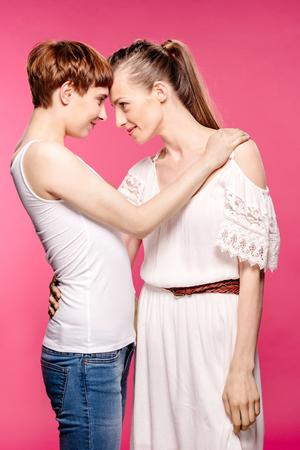 lesbian couple touching foreheads Stock Photo