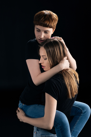 young woman lifting up girlfriend