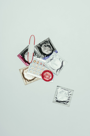 top view of pregnancy test and contraceptives