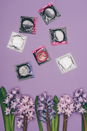top view of condoms and arranged flowers