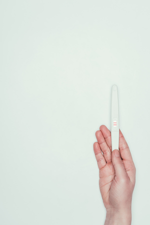 partial view of woman with pregnancy test in hand Stock fotó - 95301638