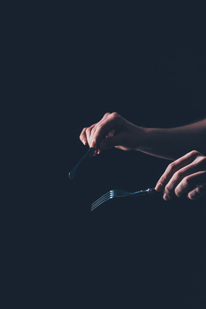 woman holding cutlery in hands Stock Photo