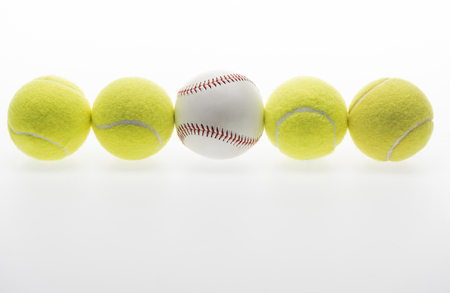 Tennis balls and baseball ball Stock Photo