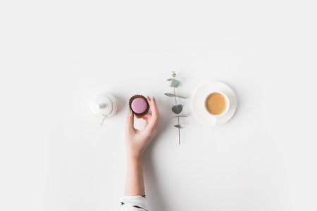 female hand and breakfast on white tabletop