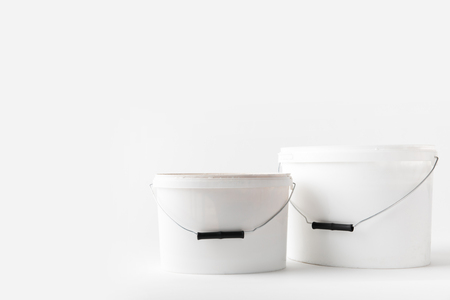 two plastic white buckets with paints Banco de Imagens - 95504090