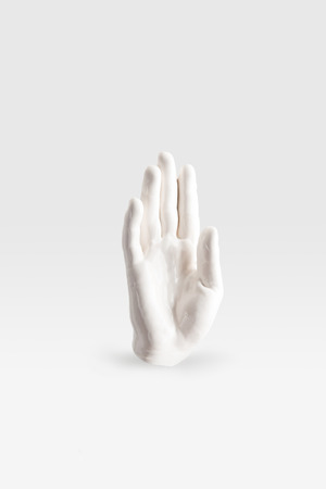 abstract sculpture in shape of human arm in white paint Stock Photo