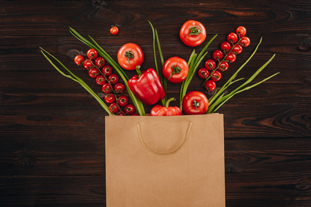 different red vegetables in shopping bag, grocery concept
