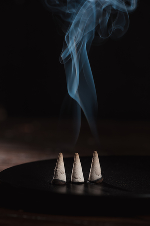 burning incense sticks with smoke
