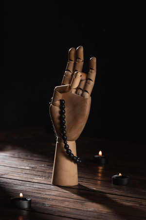 hand with prithvi mudra gesture and rosary 스톡 콘텐츠