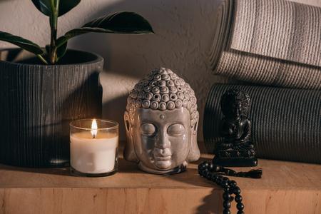 sculptures of buddha and yoga mats