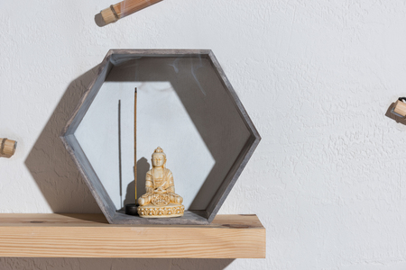 small statue of buddha in frame Stockfoto