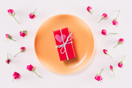 top view of valentines present box and scattered roses Stock Photo
