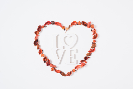 top view of heart from dried fruits with word love
