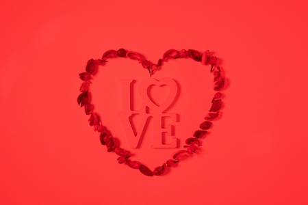 heart from dried fruits with word love isolated on red