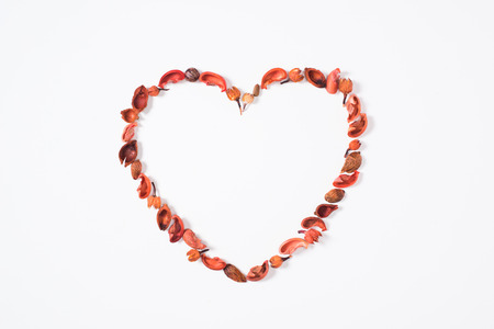 heart from dried fruits isolated on white