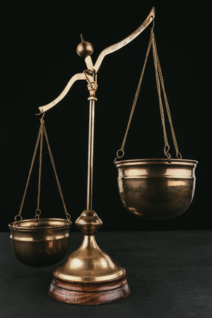 vintage justice scales isolated on black