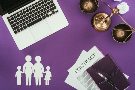 top view of business workplace with family insurance concept on purple surface