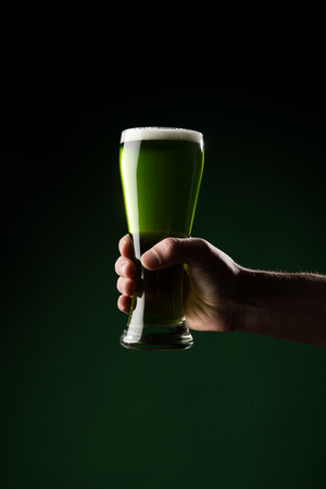 cropped image of man holding glass of green beer, st patricks day concept Stok Fotoğraf