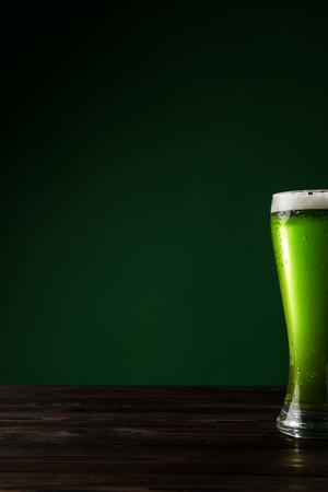 glass of green beer on wooden table, st patricks day concept Stok Fotoğraf