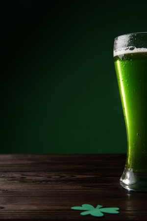 glass of green beer with shamrock on table, st patricks day concept Stok Fotoğraf