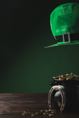 pot with golden coins, horseshoe and green hat, st patricks day concept