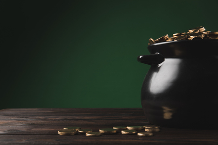 golden coins in pot and on wooden table, st patricks day concept Stok Fotoğraf
